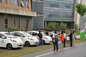 Jiaotong University students at an EV car sharing site.